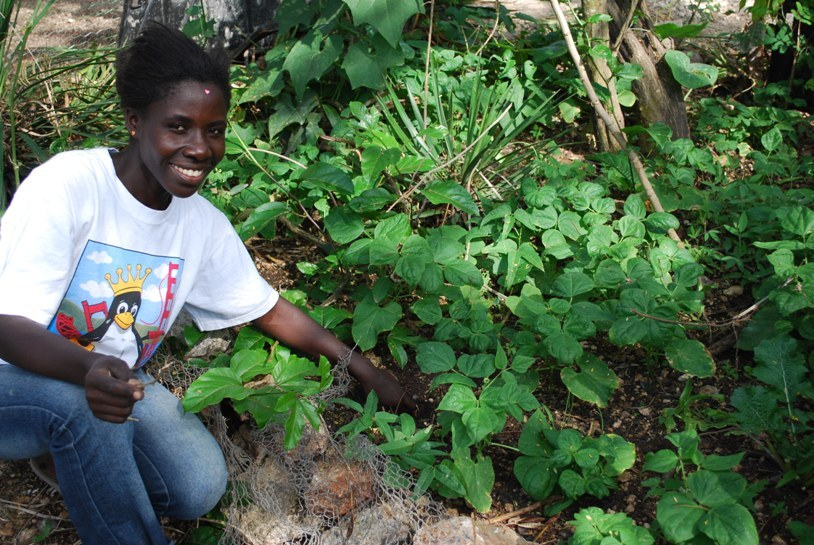 A woman in Grand Boulage, Haiti, shows off her vegetable garden.