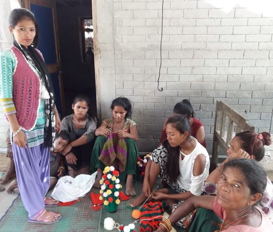 Phulmaya teaching weaving in her local place