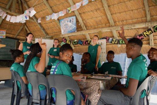 Children and Volunteers in Classroom