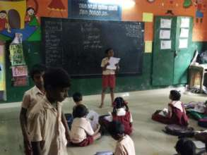 Grade 5 student teaching students in Grade 2