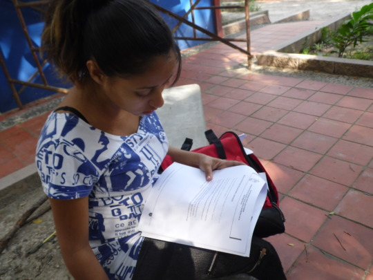 Laura reviewing notes before tutoring session