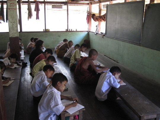 Kids studying at the free monastic school