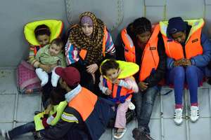 A family rescued from a sinking boat