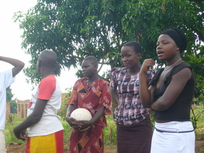 An Adolescent Club Mentor (right) leads a discussion