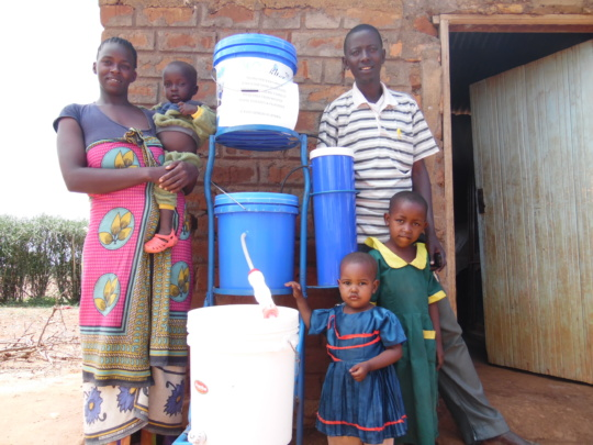 Harison and family receiving a water filter gift