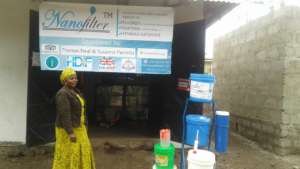Rehema at her well-branded water station
