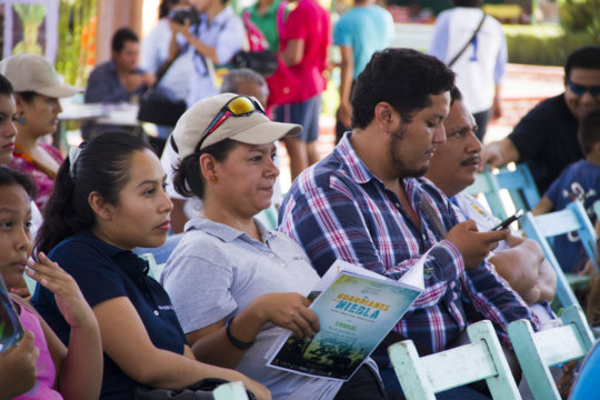 Audience members in the town square