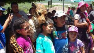 Children interact with Jaguara