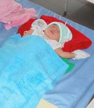 Delivery of a newborn baby at a clean safe clinic