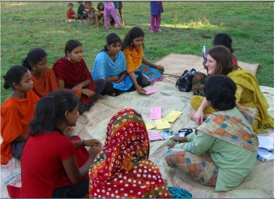 Sarah and girls discussing what they had learned