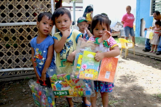 Happy beneficiaries with their school kits
