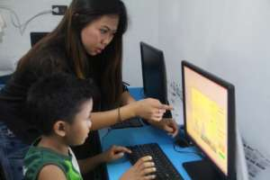 Raymart with IT Teacher Joem in computer lesson