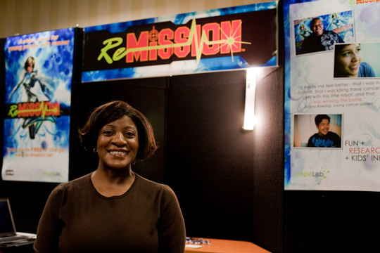 Robin Avant stands in front of our booth.