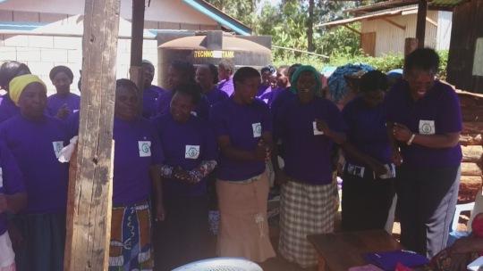 Ndia women happily receiving T-shirts from Grace-W