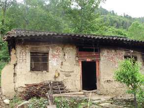 House damaged by earthquake, Huixian, China, 13 Ma