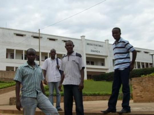 Four students in front of their university