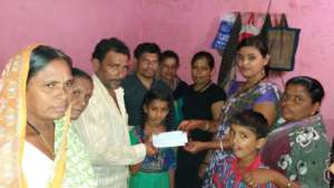 Photo of handing over the cheque to Krupa