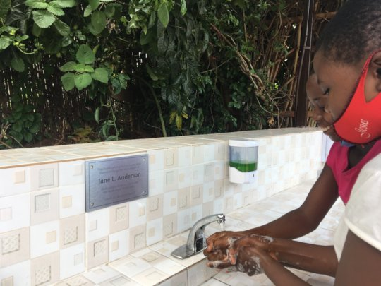 Using the new handwashing station on reopening day