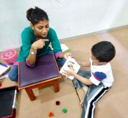 A child receiving speech therapy