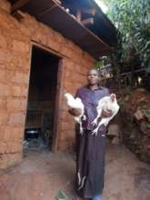 One of the women happy with her grown fowls