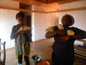 Two women received their own chickens.