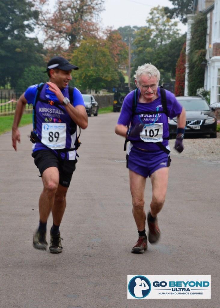 Burj (on left) still smiling at finishing line!