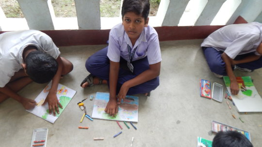 Biswanath engaged in drawing