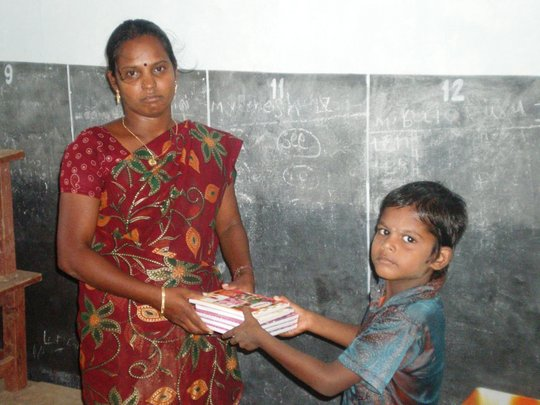 A student receives note books