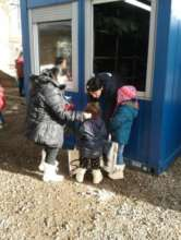 Delivery of support to the refugee family.
