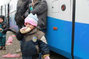 Refugee kid with the sandwich.