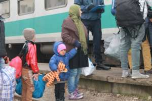 Refugee families are entering the train to Croatia