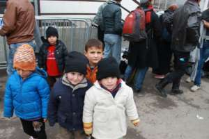 Refugee kids with the new jackets.