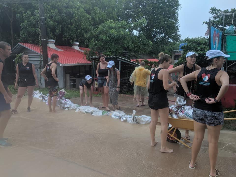 Volunteers building sandbag barrier