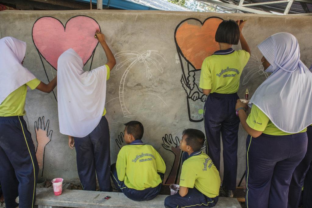 Thai Students Painting Wall Mural at Kitty City