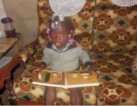Stephanie enjoying a book, a gift from CFC