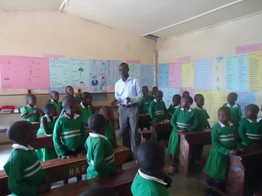 John with students at Kutamba Primary School