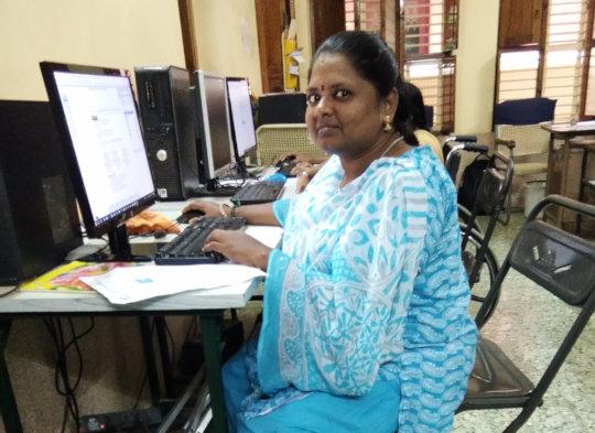 Aruna practicing her computer skills