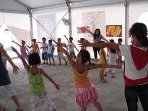 Children dancing in Half the Sky's BigTop in Sichuan