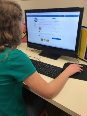 Clarkstown North student checking comments