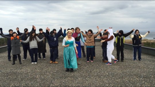 Students filming scene on the roof of their school