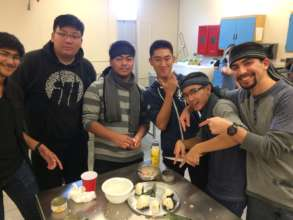 Working together to make some delicious onigiri