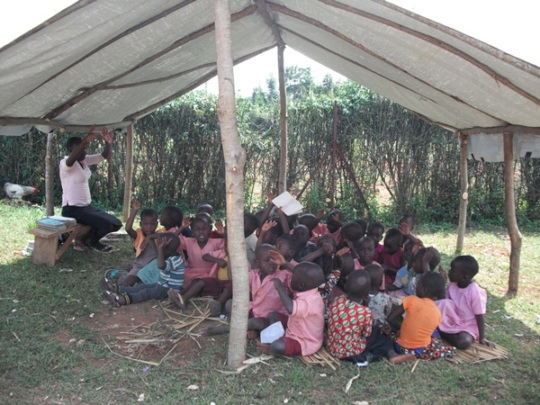 Nursery students learning in a temporary shelter.