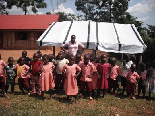 Nursery students pose with their teacher.