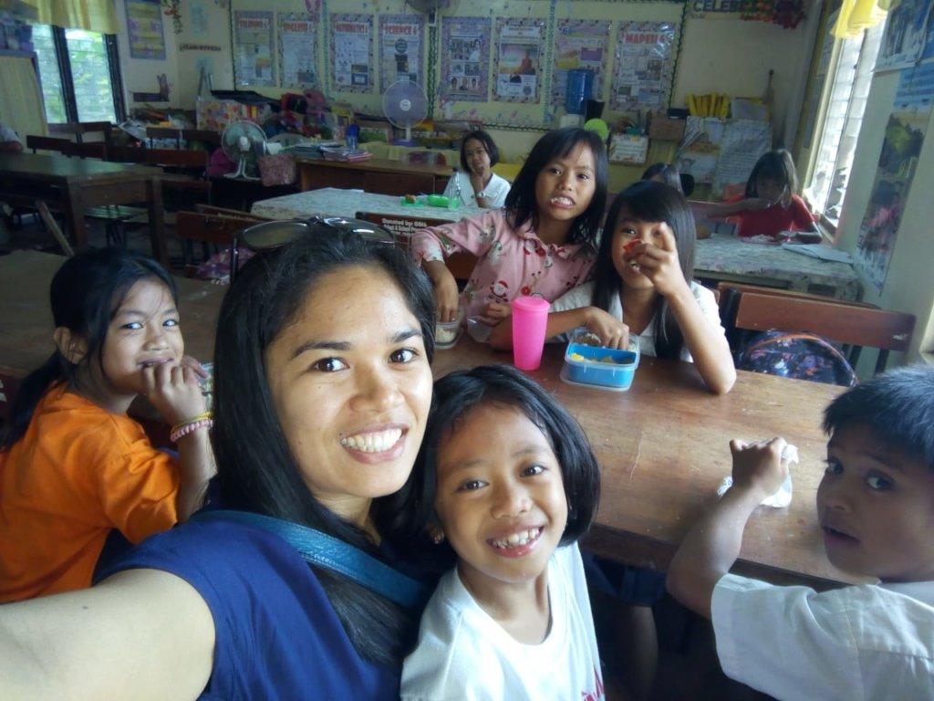 Rowena, Tacloban Coordinator, visits kids