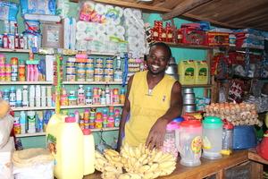 Muhire Azarias in his convenience store.