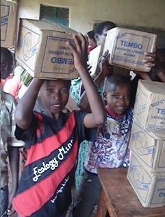 Students receiving school materials in Rwanda