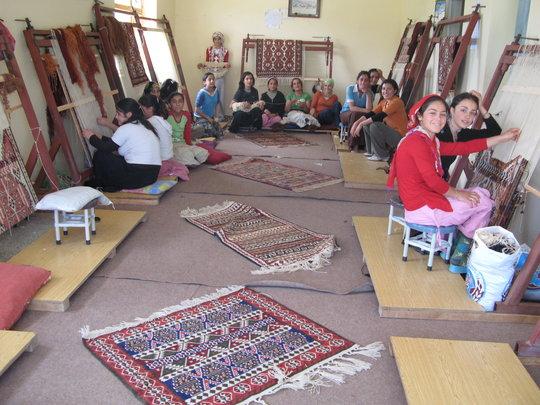 Girls weaving carpet