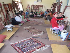 Girls weaving carpet