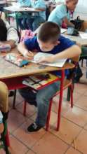 Juan Camilo with his coloring book