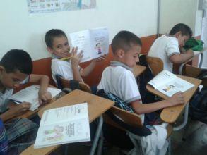 Kids woking at te workshop